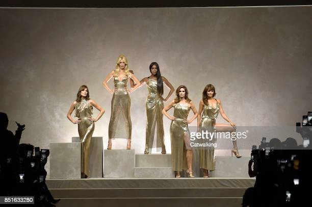 Supermodels Carla Bruni Claudia Schiffer Naomi Campbell Cindy Crawford and Helena Christensen line up for the runway finale at the Versace Spring...