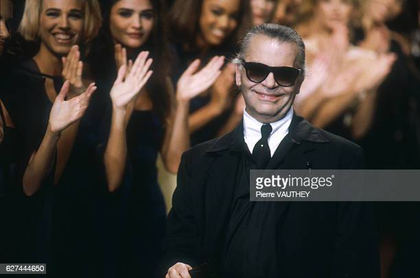Supermodels including Helena Christensen and Naomi Campbell applaud German fashion designer Karl Lagerfeld after his SpringSummer 1992 readytowear...