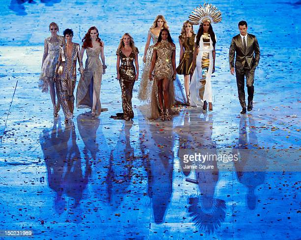 Supermodels walk the catwalk during the Closing Ceremony on Day 16 of the London 2012 Olympic Games at Olympic Stadium on August 12, 2012 in London,...