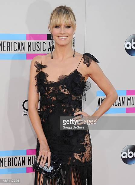 Supermodel/TV personality Heidi Klum arrives at the 2013 American Music Awards at Nokia Theatre LA Live on November 24 2013 in Los Angeles California