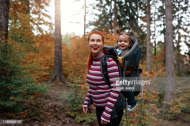 supermom and her daughter hiking in the forest - super mom stock photos and pictures