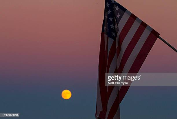 supermoon and american flag - skaneateles lake stock pictures, royalty-free photos & images