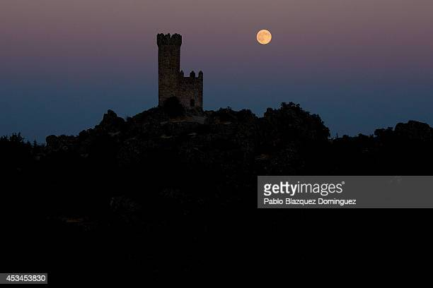 A supermoon appears behind the Torrelodones Tower on August 10 2014 in city of Torrelodones near Madrid Spain In the second supermoon or perigee moon...