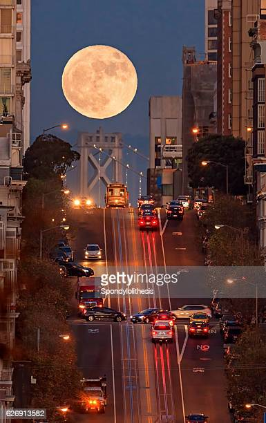 supermoon at california street composition, san francisco - san francisco california stock photos and pictures