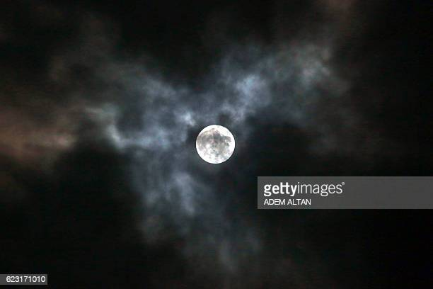 A Supermoon is pictured in Ankara on November 14 2016 The phenomenon happens when the moon is full at the same time as or very near perigee its...