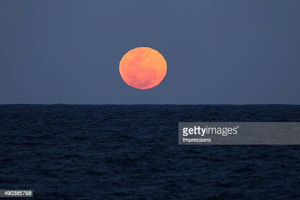 A supermoon is seen in skies over New South Wales on September 28 2015 in Sydney Australia A supermoon occurs when a full moon coincides with its...