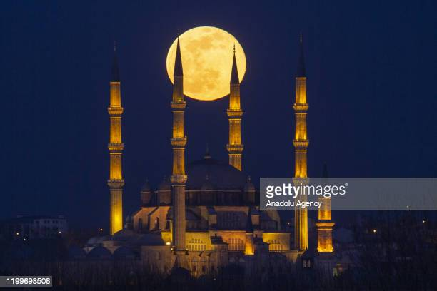 Supermoon is seen with Selimiye Mosque in Edirne Turkey on February 9 2020 Supermoon is a full moon that almost coincides with the closest distance...