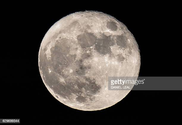 A supermoon rises above central London on December 14 2016 The phenomenon happens when the moon is full at the same time as or very near perigee its...