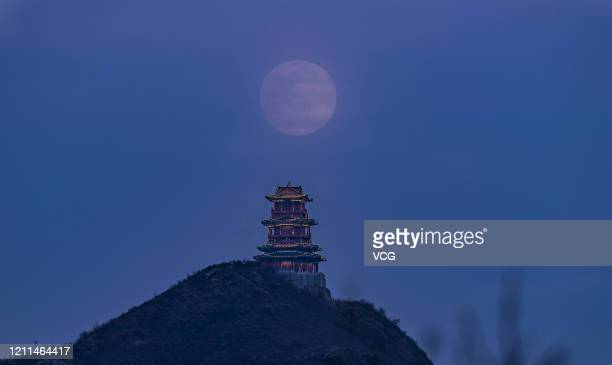 A supermoon rises above Dingdu Pavilion on March 9 2020 in Beijing China