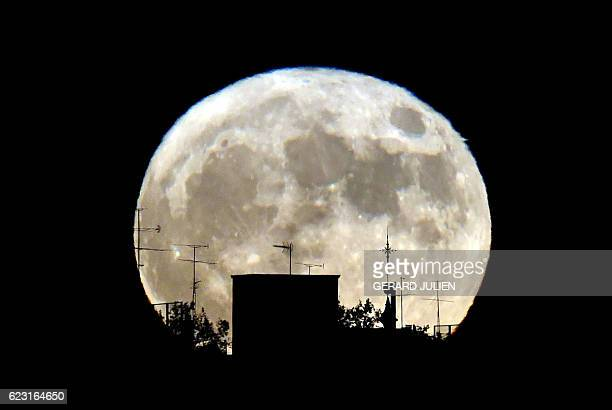 Supermoon rises against the skyline in Madrid on November 14 2016 The phenomenon happens when the moon is full at the same time as or very near...