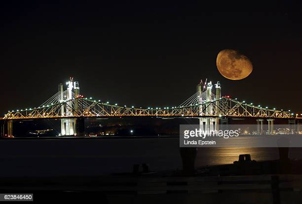 Supermoon Rises Behind the Tappan Zee Bridge Under Construction