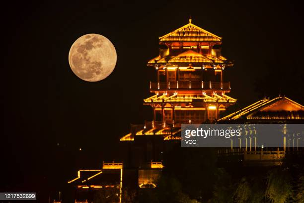 A supermoon rises over buildings on April 7 2020 in Yichang Hubei Province of China