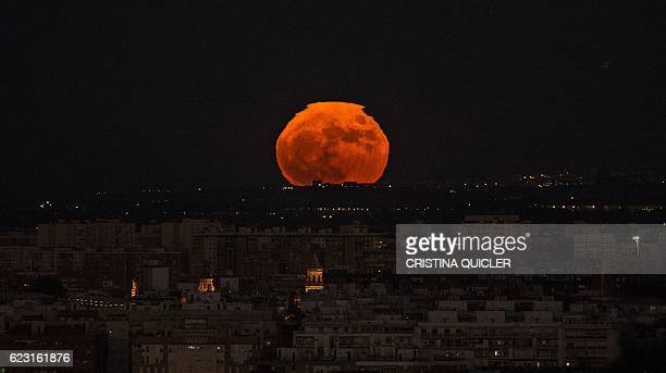 TOPSHOT A supermoon rises over Sevilla on November 14 2016 The phenomenon happens when the moon is full at the same time as or very near perigee its...