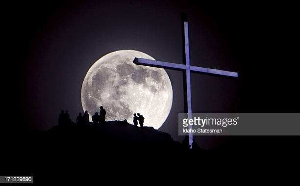 A supermoon rises over Table Rock and lighted cross in Boise Idaho on Saturday June 22 2013