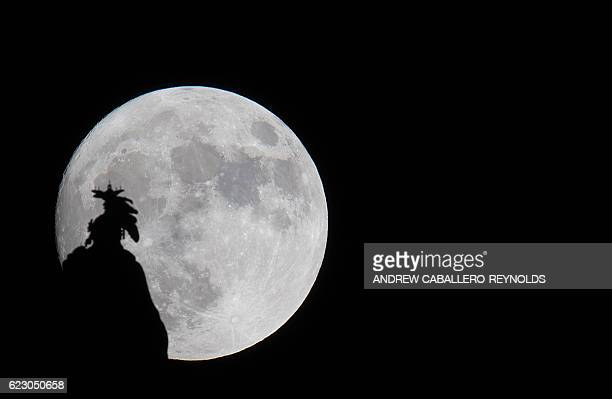 TOPSHOT A supermoon rises over the Statue of Freedom on the Capitol dome in Washington DC November 13 2016 The supermoon will venture to its closest...