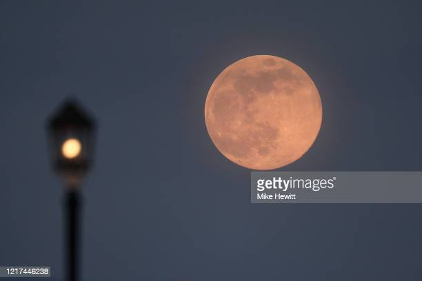 A supermoon rises over Worthing pier on April 07 2020 in Worthing United Kingdom A supermoon occurs when the moon reaches its closest position to the...