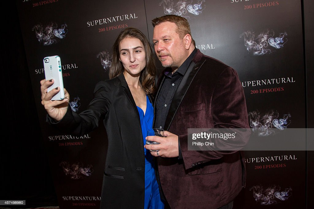 'Supernatural' executive producer Adam Glass and Mia Glass attend the 'Supernatural' 200th episode celebration at the Fairmont Pacific Rim Hotel on October 18, 2014 in Vancouver, Canada.