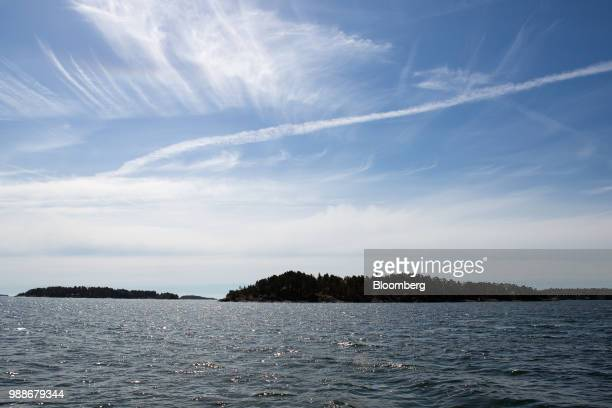 SuperShe island, right, sits in the Baltic sea near Raasepori, Finland, on Wednesday, June 27, 2018. The price of experimental networking on the...