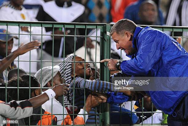 AFRICA APRIL 23 SuperSport head coach Gavin Hunt greets fans after the Absa Premiership match between SuperSport United and Orlando Pirates at Loftus...