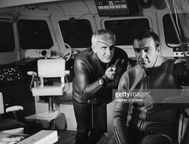Superspy James Bond played by actor Sean Connery is held at knifepoint by Adolfo Celi as Emilio Largo in a scene from the film 'Thunderball' being...