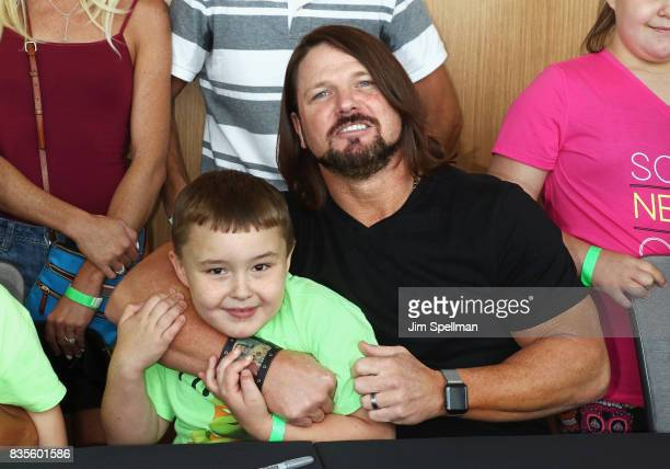 Superstar A.J. Styles poses with a wish kid at the WWE Superstars Surprise Make-A-Wish Families at One World Observatory on August 19, 2017 in New...