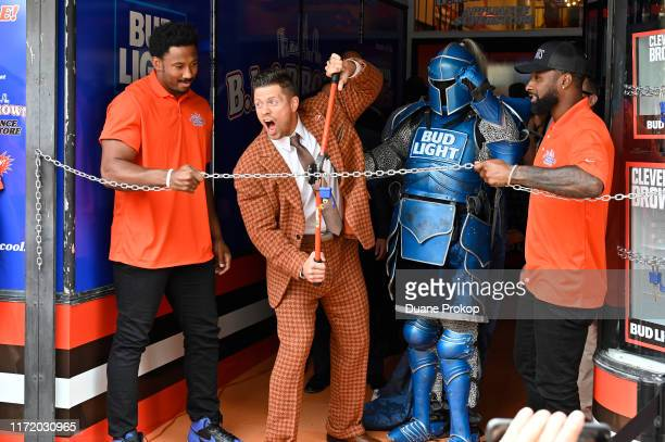 """Superstar and Browns Superfan, The Miz and Cleveland Browns players Miles Garrett and Jarvis Landry attend the opening of Bud Light's """"B.L. & Brown's..."""