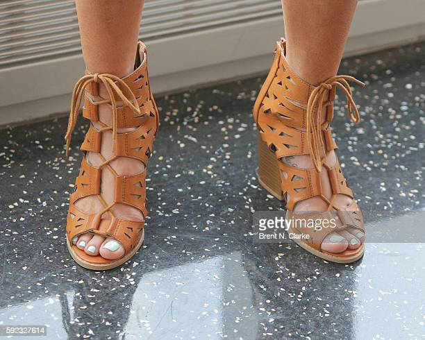 WWE superstar Carmella shoe detail poses for photographs during her visit to One World Observatory in advance of SummerSlam on August 20 2016 in New...