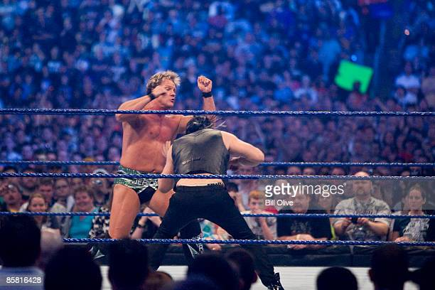 WWE Superstar Chris Jericho gets a punch to the gut by actor Mickey Rourke as they duel during WrestleMania 25 at Reliant Stadium on April 5 2009 in...