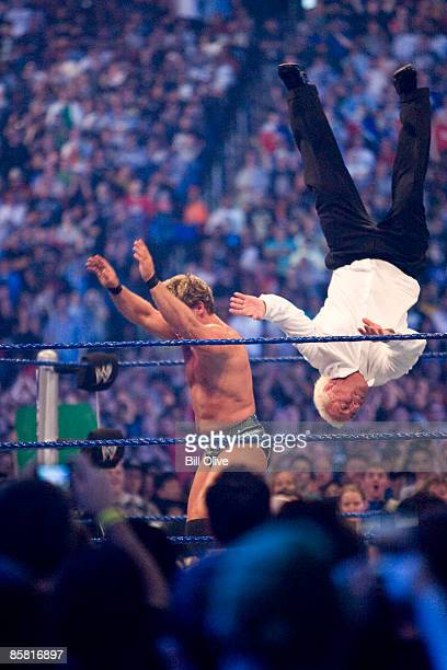 WWE Superstar Chris Jericho throws into the air former professional wrestler Ric Flair during WrestleMania 25 at Reliant Stadium on April 5 2009 in...