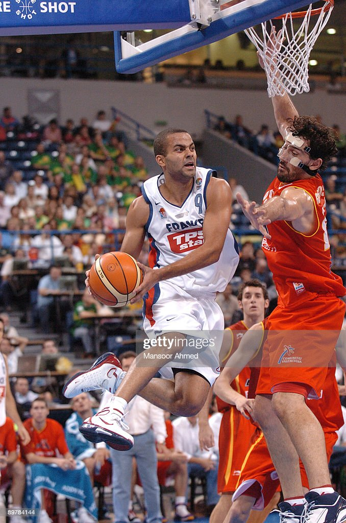 Superstar Frenchman Tony Parker of two-time defending NBA champions San Antonio Spurs is in mid-flight as he attempts to make the pass away from the outstretched advances of Spain's Jorge Garbajosa during the Bronze medal match of the European Basketball Championships at the Belgrade Arena, Belgrade, Serbia & Montenegro, 24th September 2005.