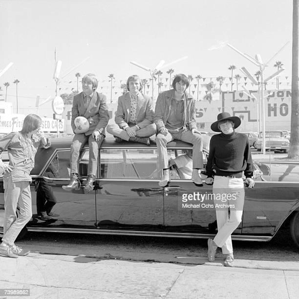 Superstar group 'Buffalo Springfield' pose for a portrait sitting on a car in 1966 in Los Angeles California Bruce Palmer Dewey Martin Stephen Stills...