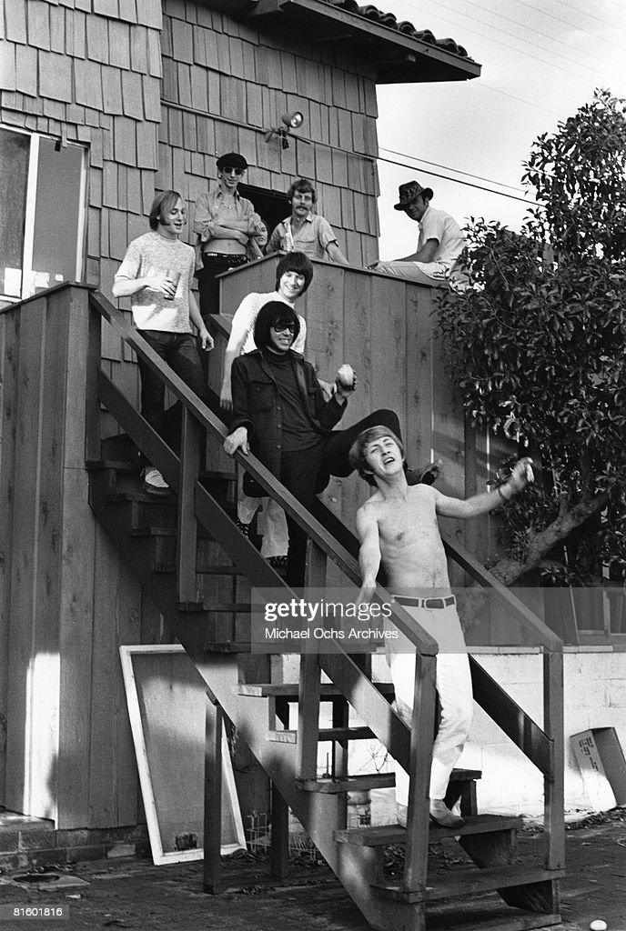 Superstar group 'Buffalo Springfield' pose for a portrait with two unidentified men on the steps of their house on October 30, 1967 in Malibu, California. (Bottom to top) Dewey Martin, Neil Young, Richie Furay, Stephen Stills, Bruce Palmer.