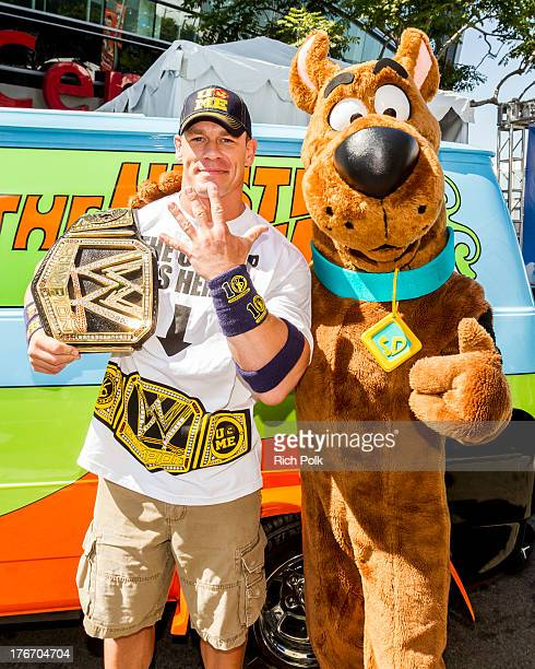 Superstar John Cena runs into Scooby backstage at Summerslam's Fan Axxess The two will reunite this spring in WWE Studios Warner Bros ScoobyDoo...