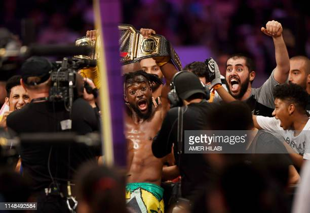 WWE Superstar Kofi Kingston is surrounded by fans at the end of the World Wrestling Entertainment Super Showdown event in Saudi Arabia's Red Sea port...
