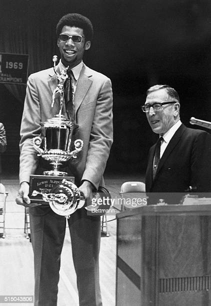 Superstar Lew Alcindor has his hands full as he holds two of the many awards he was given at the UCLA Basketball Awards Ceremony at the school's...