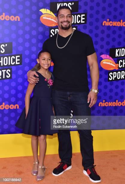 Superstar Roman Reigns and JoJo Anoa'i attend Nickelodeon Kids' Choice Sports Awards 2018 at Barker Hangar on July 19 2018 in Santa Monica California