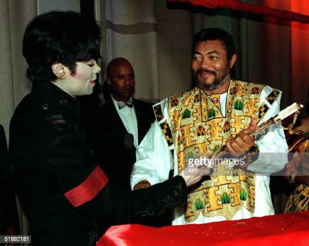 Superstar singer Michael Jackson presents a gold sword to the President of the West African nation of Ghana Jerry Rawlings on behalf of Saudi Arabian...