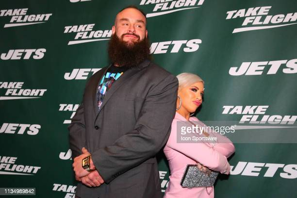 Superstars Braun Strowman and Dana BrookeTM pose for photos on the green carpet at the New York Jets New Uniform Unveiling on April 4, 2019 at Gotham...