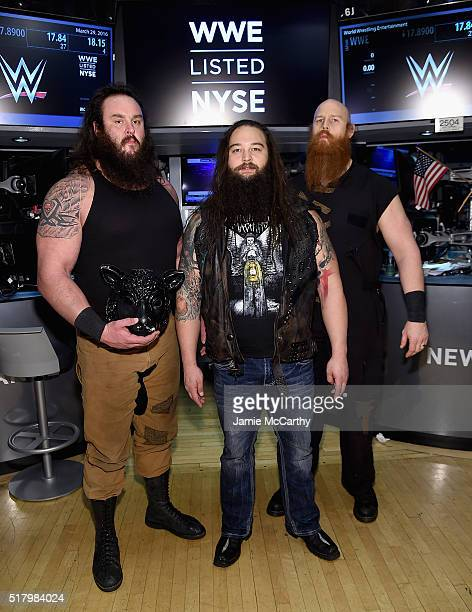 Superstars Braun Strowman Bray Wyatt and Erick Rowan ring The New York Stock Exchange Opening Bell in honor of WrestleMania 32 at New York Stock...