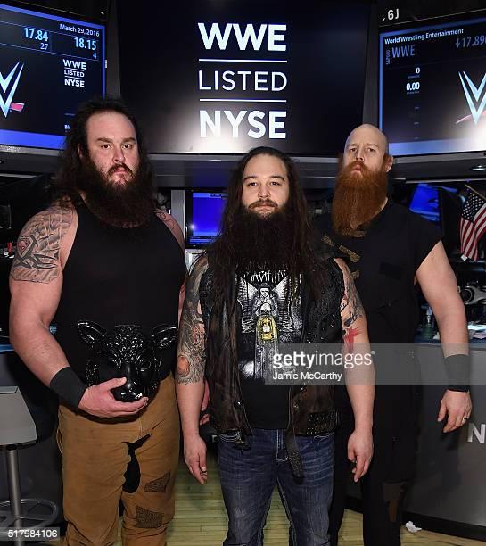 Superstars Braun Strowman Bray Wyatt and Erick Rowan ring The New York Stock Exchange Opening Bell in honor of WrestleMania 32 at New York Stock...