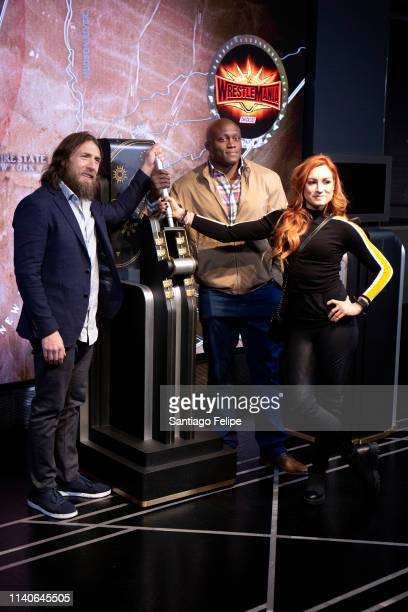 Superstars Daniel Bryan Becky Lynch and Bobby Lashley Celebrate Wrestlemania 35 at The Empire State Building on April 05 2019 in New York City