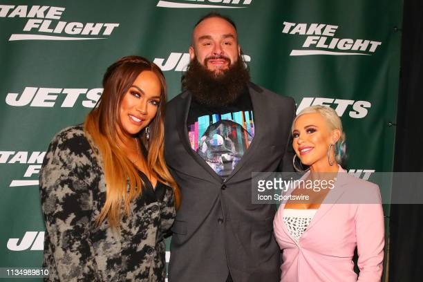 Superstars Nia Jax®, Braun Strowman and Dana BrookeTM pose for photos on the green carpet at the New York Jets New Uniform Unveiling on April 4, 2019...