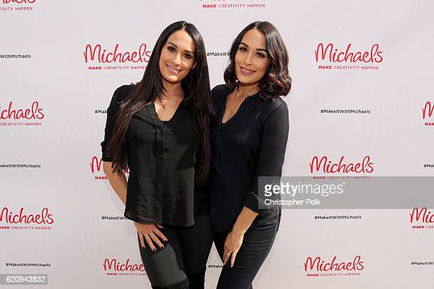 WWE superstars Nikki Bella and Brie Bella behind the scenes of Making with Michaels on October 31 2016 in Los Angeles California