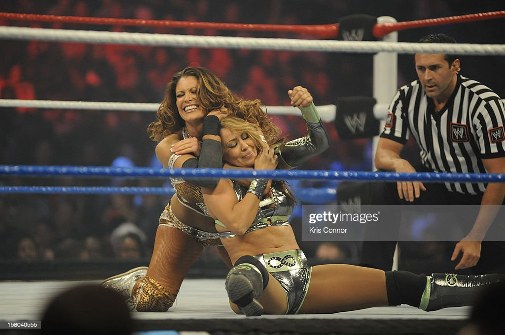 Superstars WWE Dive Eve Torres and WWE Diva Layla wrestle during 10th anniversary of WWE Tribute to the Troops at Norfolk Scope Arena on December 9, 2012 in Norfolk, Virginia.