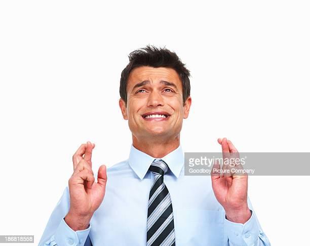 Superstitious Geschäftsmann auf weißem Hintergrund