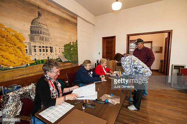 Supervising Election Judge Angeline Wootten L prepares ballots for voters November 4 2014 in Hayes Township Franklin County near Ottawa Kansas A...
