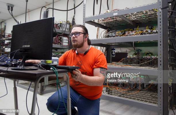 Supervising technician Jeremy Bailey checks monitors equipment at OregonMines a hardware hosting service for cryptocurrency miners on March 12 2018...