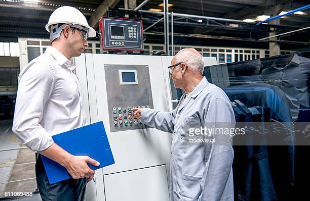 Supervisor and workers in factory