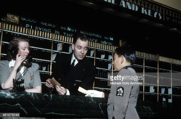 Supervisor at the front desk gives instructions to the porter in The Plaza Hotel in New York, New York.