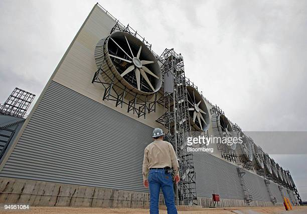 Supervisor Chad Horton looks up at a bank of fans used in the heating proces at the Freeport LNG facility in Quintana Texas US on Wednesday April 1...